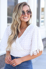 White - Crochet Crop Top styled with flare jeans at dress up