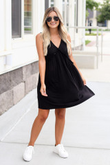 Model wearing the Swing Dress in Black with white sneakers