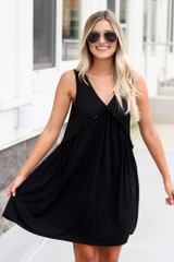 Dress Up model wearing the Swing Dress in Black with aviator sunglasses