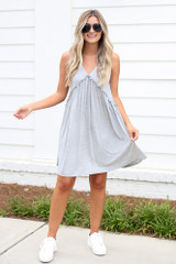 Dress Up model wearing the Swing Dress in Heather Grey with white sneakers