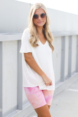 Dress Up model wearing the Tie-Dye Biker Shorts in Pink with an oversized tee