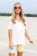 Dress Up model wearing the Tie-Dye Biker Shorts in Yellow with a white oversized tee