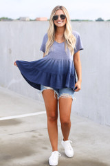 Model wearing the Ombre Babydoll Top in Navy with platform sneakers