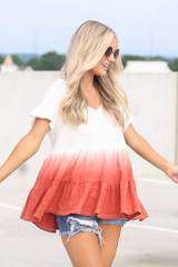 Dress Up model wearing the Ombre Babydoll Top in White with distressed denim shorts