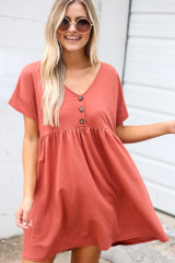 Model wearing the Button Front Babydoll Dress in Wine