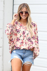Model wearing the Floral Oversized Blouse with denim shorts