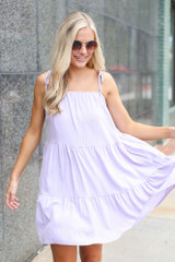 Model wearing the Tiered Babydoll Dress with aviator sunglasses