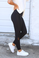 Close Up Side View of the Moto High-Rise Leggings in Black