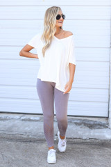 Model wearing the Seamless High-Waisted Leggings with a white oversized tee