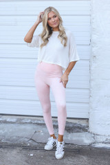 Model wearing the High-Waisted Ribbed Leggings in Peach with a white tee