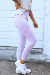 Model wearing the High-Waisted Ribbed Leggings in Lavender Side View