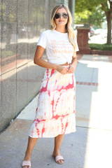 Model wearing the Tie-Dye Midi Skirt with a graphic tee
