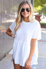 Model wearing the Babydoll Top in White with aviator sunglasses