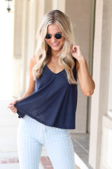 Model wearing the Relaxed Fit Tank in Navy with light wash jeans