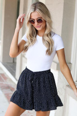 Model wearing the Polka Dot Shorts in Black with a white bodysuit
