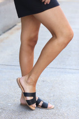 Model wearing the Cutout Slip On Sandals in Black