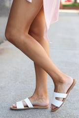 Model wearing the Cutout Slip On Sandals in White Side View
