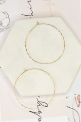 Flat Lay of the Textured Hoop Earrings