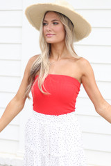 Red - Model wearing the Strapless Ribbed Bodysuit with a straw sun hat