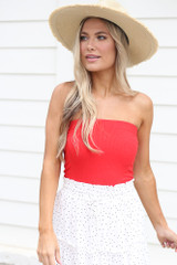 Red - Dress Up model wearing the Strapless Ribbed Bodysuit with a white mini skirt