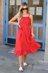 Dress Up model wearing the Smocked Ruffle Midi Dress with white sandals