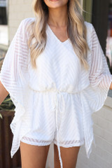 Close Up of the Swiss Dot Chevron Romper in White