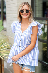 Model wearing the Striped Button Front Babydoll Blouse with distressed mom shorts