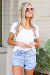 Dress Up model wearing the Cuffed Distressed Denim Shorts with a white tee