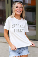 Dress Up model wearing the Avocado Toast Graphic Tee with distressed denim shorts