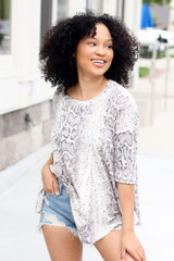 Model wearing the Oversized Snakeskin Waffle Knit Top with denim shorts