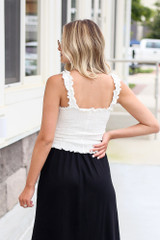 back view smocked crop top with black skirt
