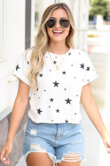 Dress Up model wearing the Cropped Star Tee with distressed denim shorts