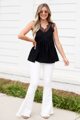 Dress Up model wearing the Lace Babydoll Tank with white flare jeans