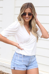 Model wearing the Puff Sleeve Blouse in Ivory