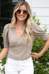 Model wearing the Puff Sleeve Blouse in Taupe