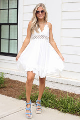 Model wearing the Lace Slip Dress in White with platform espadrilles