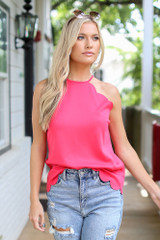 Model wearing the Scalloped Tank in Red with denim shorts