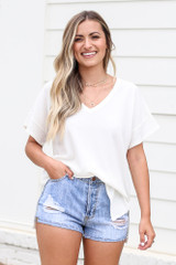 Dress Up model wearing the Textured Oversized Top with denim shorts
