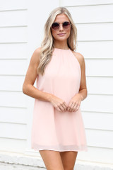 Blush - Dress Up model wearing the Halter Swing Dress with sunglasses