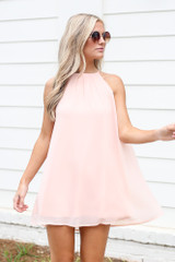 Blush - Model wearing the Halter Swing Dress with sunglasses