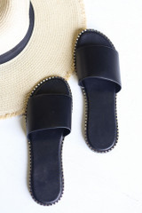 Flat Lay of the Studded Slip On Sandals in Black