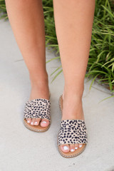 Model wearing the Studded Slip On Sandals in Spotted