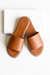 Flat Lay of the Studded Slip On Sandals in Tan