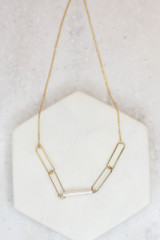 Flat Lay of the Pearl Bar Necklace