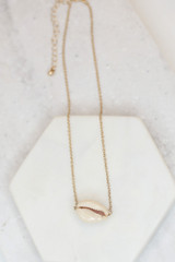 Flat Lay of the Cowrie Shell Necklace