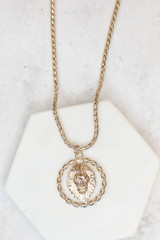 Flat Lay of the Lion Pendant Necklace
