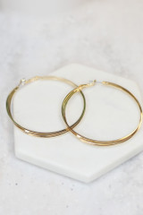 Gold - Flat Lay of the Twisted Hoop Earrings