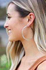 Silver - Model wearing the Twisted Hoop Earrings