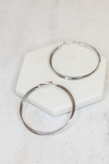 Silver - Flat Lay of the Twisted Hoop Earrings on a white background
