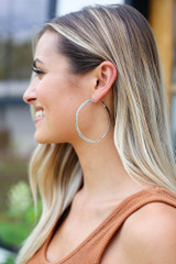 Model wearing the Twisted Hoop Earrings in Silver